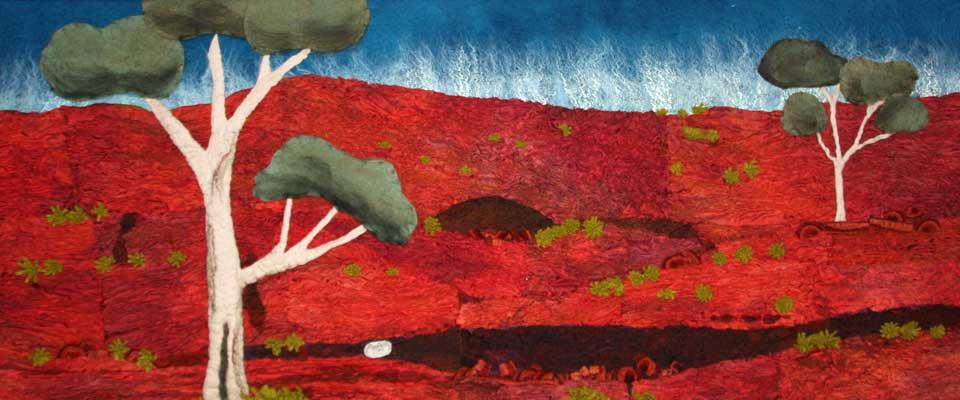 Red rocks, white trees, blue sky